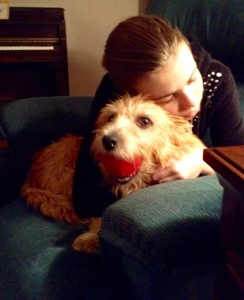 Truisuit cuddling at her forever home with Caryn Rippey